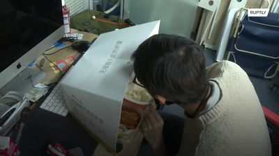 Chinese food delivery service offers anti-coronavirus 'eating shield' to diners