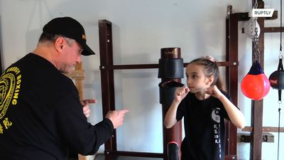 Pushy parent or just protective? Eight-year-old practises martial arts every day to learn how to fig
