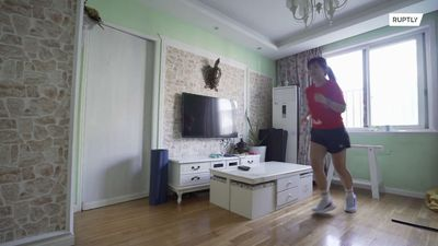 Chinese sports enthusiast beats coronavirus lockdown by running 10K in living room