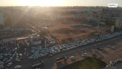 Drone footage captures massive queues at Khartoum petrol station amid COVID-19 lockdown
