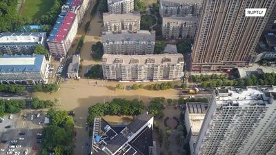 Wuhan raises flood alert level as severe rainfall batters China