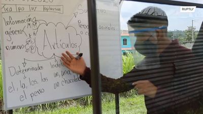 Guatemalan teacher uses tricycle classroom to teach students during COVID lockdown