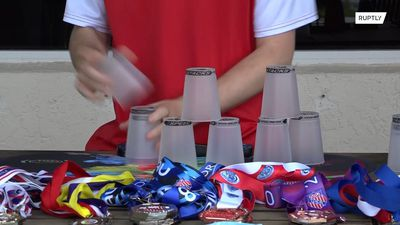 Watch this Florida sport stacking champion arrange cups in record time