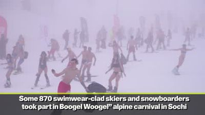 Skiers in swimsuits take to the slopes at ''Boogelwoogel'' carnival