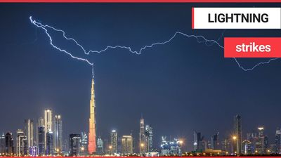 Photographer captures the amazing moment the Burj Khalifa is struck by a huge lightning bolt - after