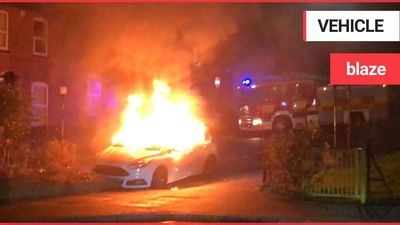 This dramatic footage and series of images shows a car engulfed by flames on a residential street la