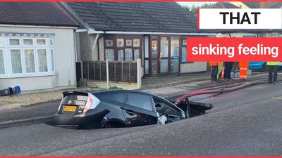 Motorist had a miracle escape after driving car into a SINKHOLE