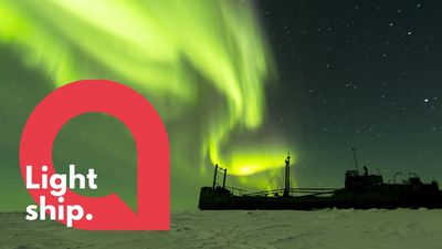 Stunning photographs of northern lights above shipwrecked boat