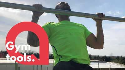 A scaffolder creates his own gym routine in the yard