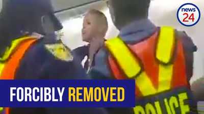 WATCH: 'Unruly' passenger forcibly removed from Kulula flight