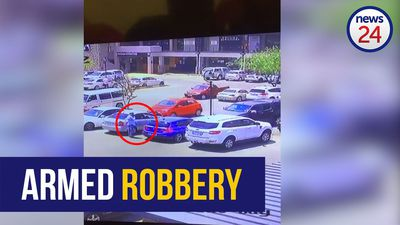 WATCH: Woman robbed at gunpoint outside Midrand shopping centre