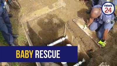 WATCH: Rescue workers attempt to save baby from drain pipe