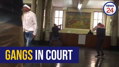 WATCH: Police draw arms as rival gang members clash in Joburg court