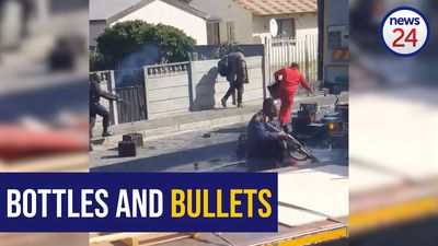WATCH- Booze truck looters disperse as cops fire rubber bullets.mp4