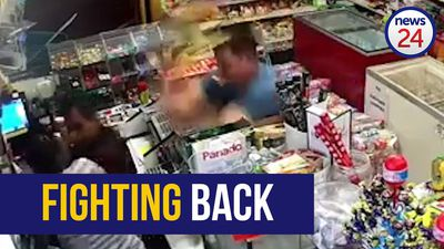 WATCH | Customer stumbles across armed robbery… see what happens next