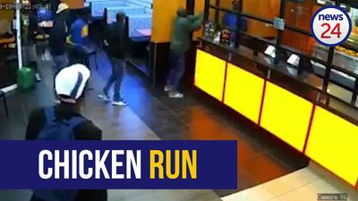 WATCH | Armed robber feed their craving for cash after robbing Chicken Licken