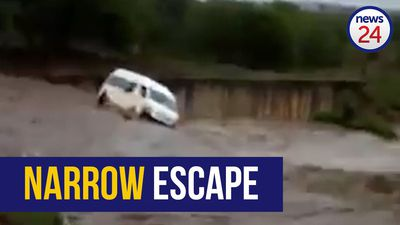 WATCH | Taxi swept away in heavy KZN rains