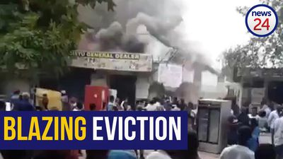 WATCH | Foreign nationals allegedly torch building after eviction