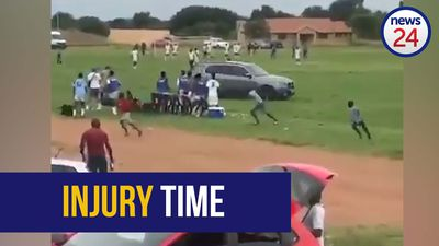 WATCH | Fast and furious: Soccer players run for cover as car speeds onto field