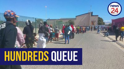 WATCH | Hundreds queue shoulder-to-shoulder in baking sun for their monthly social grants