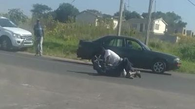 MOTORISTS IN STREET FIGHT!