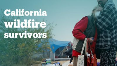 Wildfire survivors live in a makeshift tent camp
