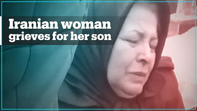 Iranian woman grieves for son killed by Iran missile