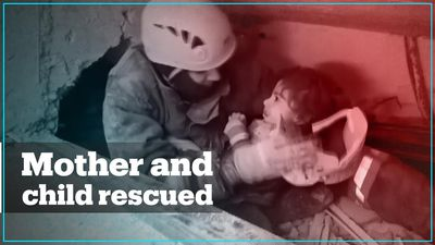 Rescue teams save woman and child in Turkey's quake-hit city