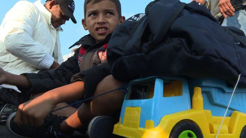 Migrant children find comfort in their toys as they travel to US