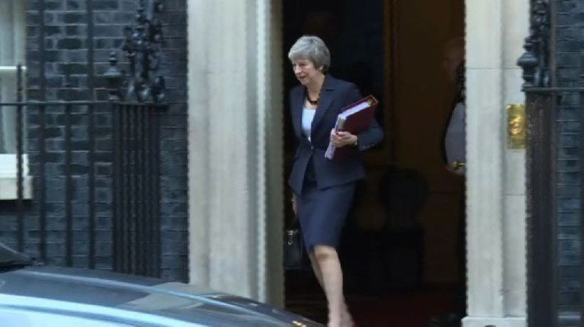 Theresa May leaves Downing Street to attend PMQs