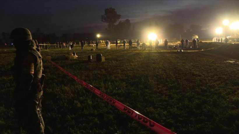 Forensic scientists in Mexico work scene of fuel pipeline fire