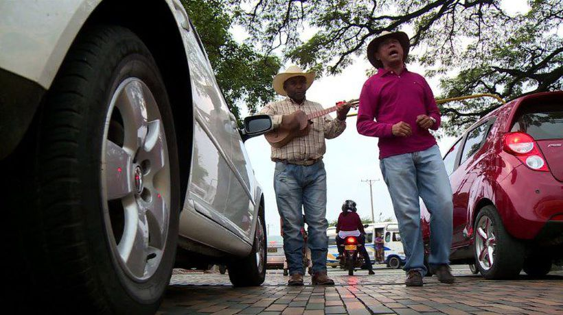 Venezuelans busk on the streets of Colombia