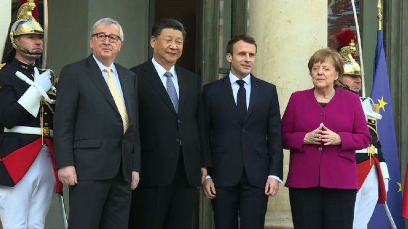 Macron, Merkel and Juncker greet Xi Jinping at Élysée Palace