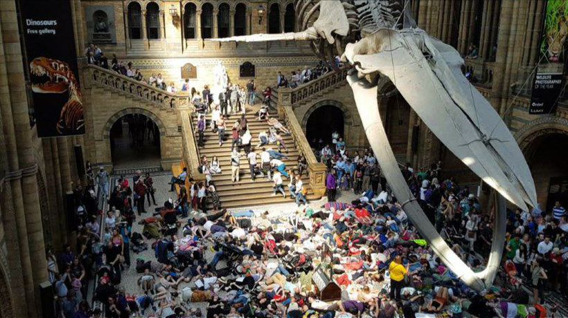 Extinction Rebellion stages 'die-in' under London's blue whale