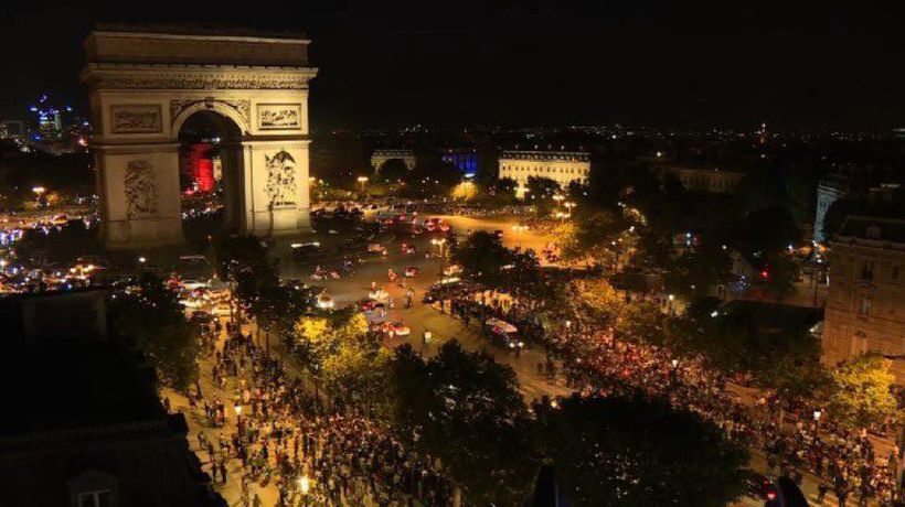 Algerians celebrate team's win on the Champs Elysées