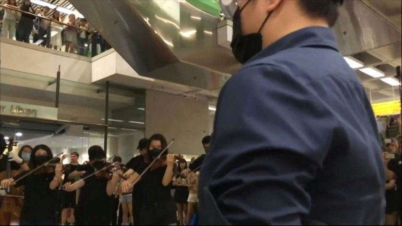 Symphony of demonstration: Orchestra performs protest anthem at HK mall