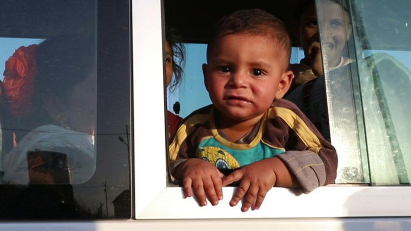 Hundreds of Syrian Kurds fleeing Turkish invasion seek refuge in Iraq