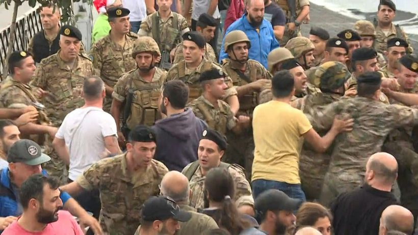 Protesters confront Lebanese soldiers attempting to open roads