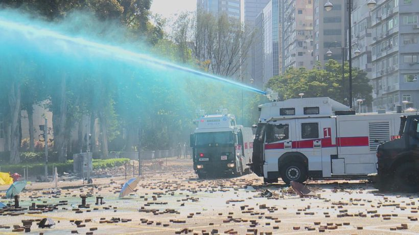 Hong Kong police launch water cannon outside university campus