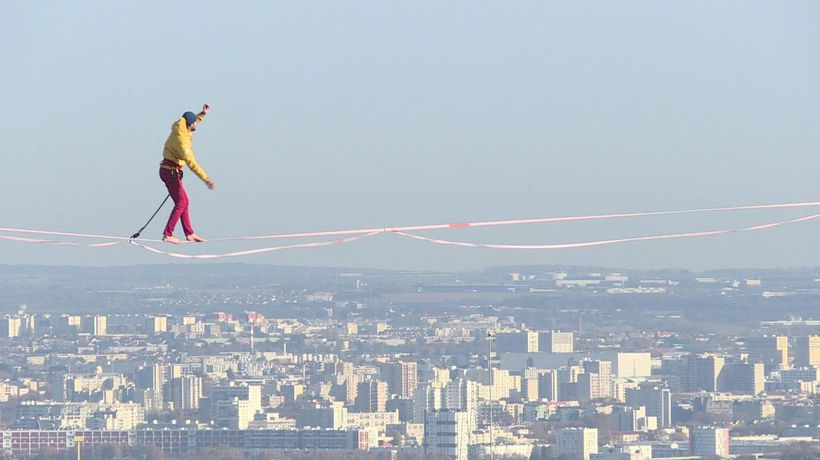 Paris: tightrope walker hovers 150 m above ground, crossing the void between towers in the business