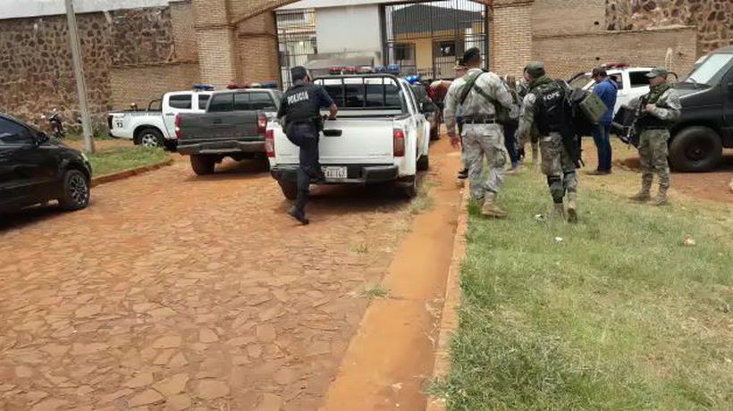 Images of police outside Paraguay jail where 76 inmates escaped
