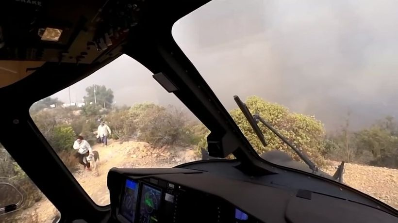 Helicopter rescues people, dogs from wildfire