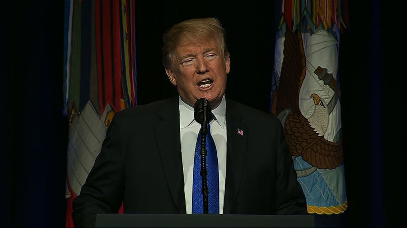 Launching new missile strategy, Trump pushes wall