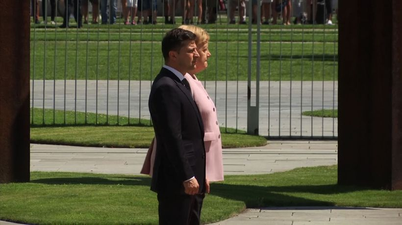 Merkel says she's OK after shaking at ceremony