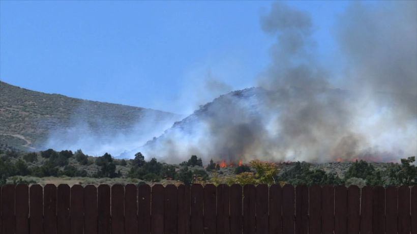 Wildfire threatens about 100 homes near Reno
