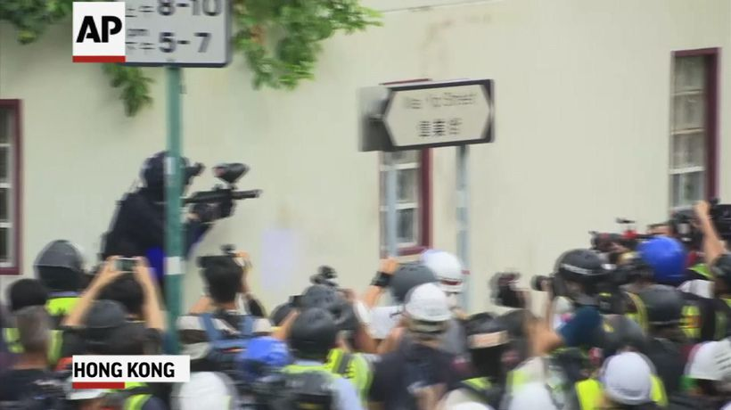 Protesters and riot police clash in Hong Kong