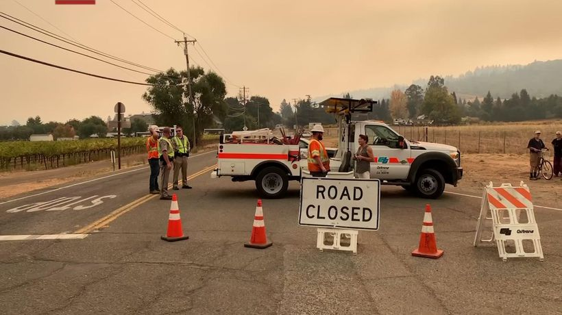 Thousands evacuate as winds fuel California wildfire