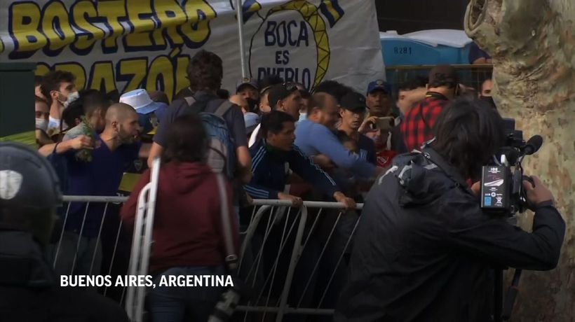 Maradona fans try to rush building to see coffin