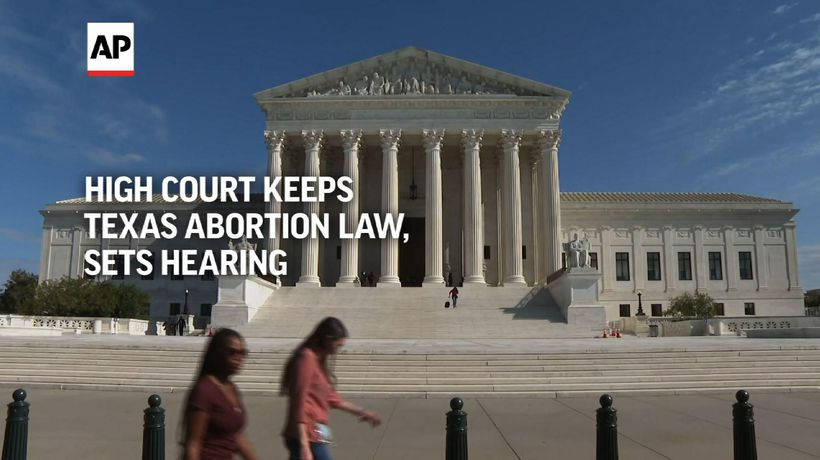High court keeps Texas abortion law, sets hearing