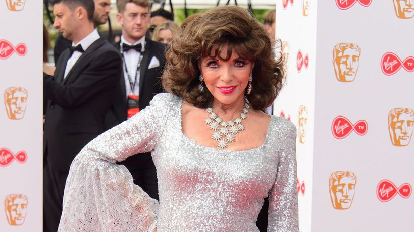 Joan Collins calls police after spotting 'maskless workmen on her balcony'